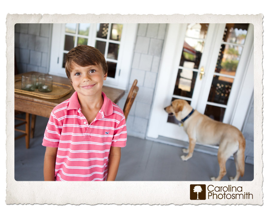 A boy and his dog enjoy salty breezes on this Isle of Palms porch by Carolina Photosmith