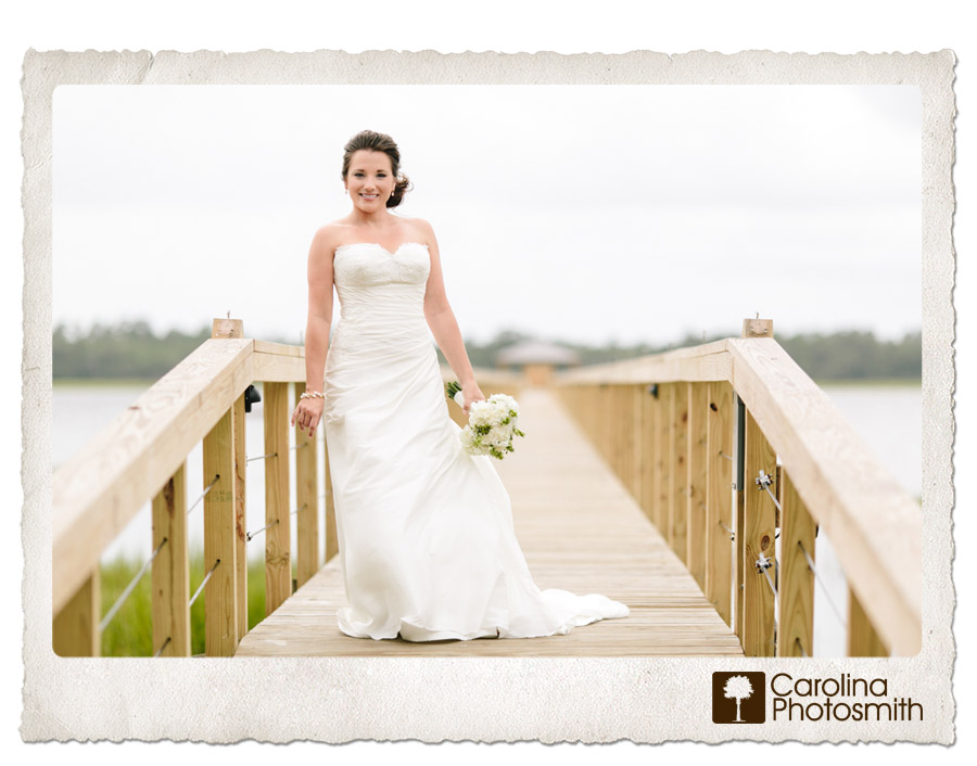 Lowndes Grove bridal portrait on the pier leading to the Ashley River. www.carolinaphotosmith.com