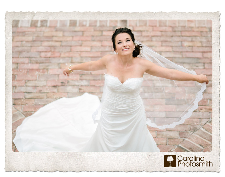 Beautiful Charleston bride soaks up the sun at her Lowndes Grove portrait session.