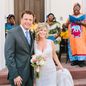 The newlyweds take it all in as Charleston's Plantation Singers belt out