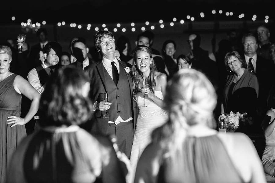 Bridesmaids toast happy newlyweds at Lowndes Grove wedding in Charleston, SC. © Carolina Photosmith