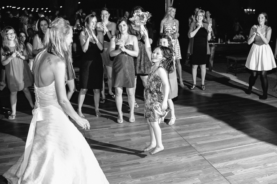 Young wedding guest snags bride