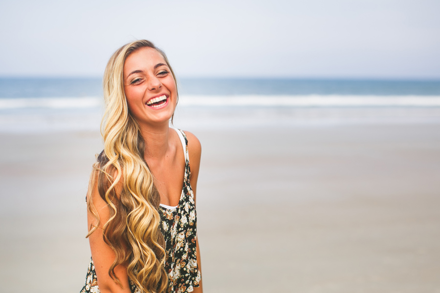 vibrant and fun senior portraits on the beach © Carolina Photosmith