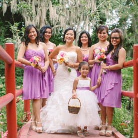 Stunning bride, gorgeous bridesmaids in radiant orchid with colorful bouquets at Magnolia Plantation. © Carolina Photosmith