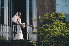 Charleston bride on balcony at Confederate Home © Carolina Photosmith