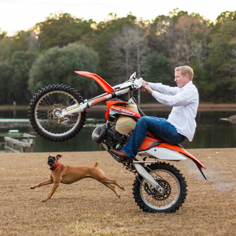 Bubba and his fave Boxer love tricks on the dirt bike at Wadmalaw property. © Carolina Photosmith