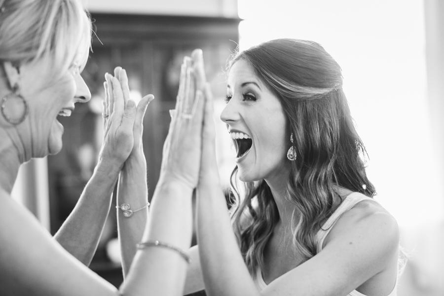 Bride and her mom share a high ten. © Carolina Photosmith