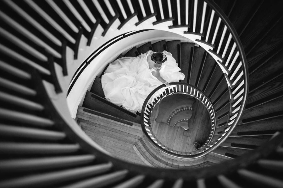 Lowndes Grove bridal portrait. Staircase like a nautilus. © Carolina Photosmith
