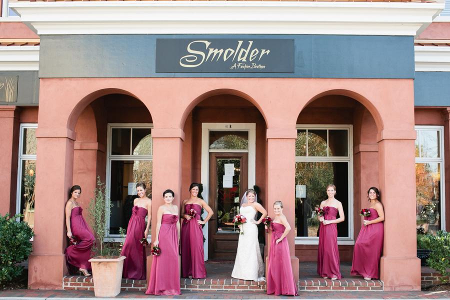 Long chiffon bridesmaids in a wine - marsala palette. © Carolina Photosmith