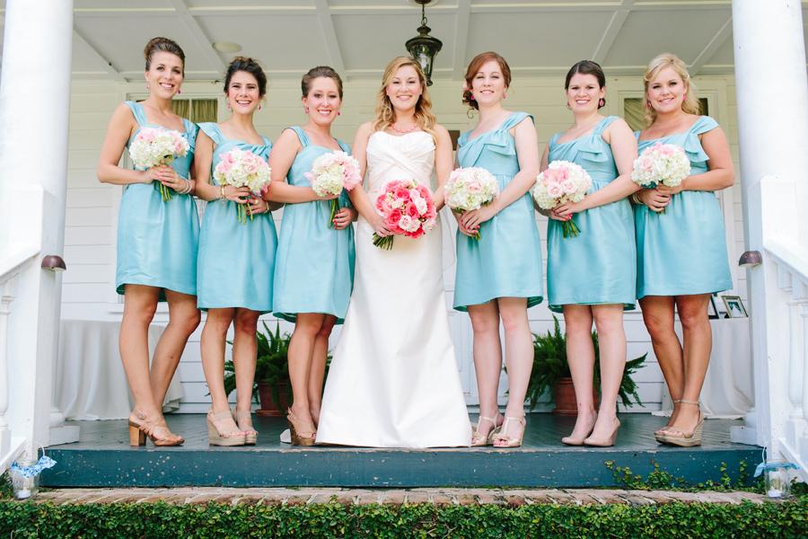Light blue bridesmaids and coral roses at Wideawake Plantation. © Carolina Photosmith