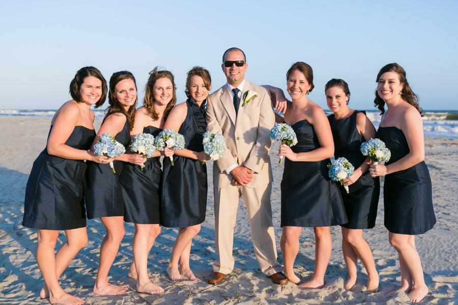 True navy bridesmaids on the beach. © Carolina Photosmith