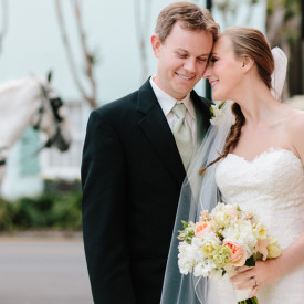 Historic Charleston wedding featuring carriage ride from church to Old Exchange Building ©Carolina Photosmith
