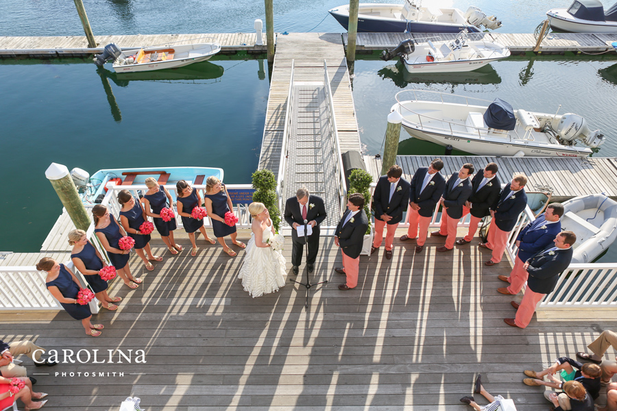 Nantucket reds and navy bridesmaids at Kennebunk River Club wedding. © Carolina Photosmith