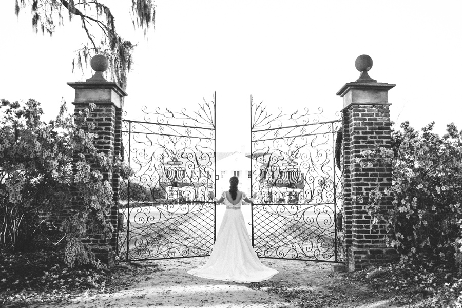 Romantic bridal portrait at the elegant gates of Boone Hall Plantation in Mt. Pleasant, SC. © Carolina Photosmith