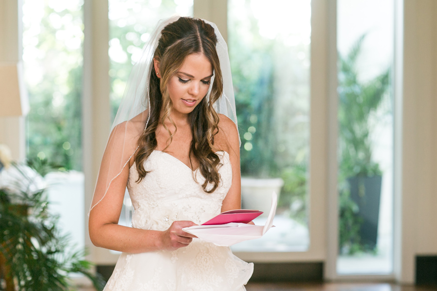 Bride reads card from her almost-husband. Daniel-Island-Club-outdoor-wedding. © Carolina Photosmith