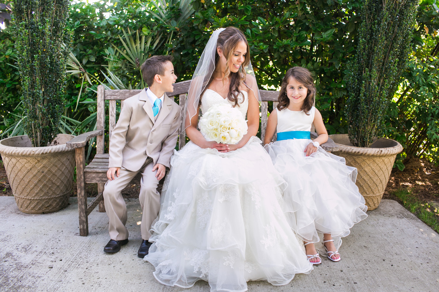 Daniel Island Club bride shares a moment with her ring bearer and flower girl. © Carolina Photosmith