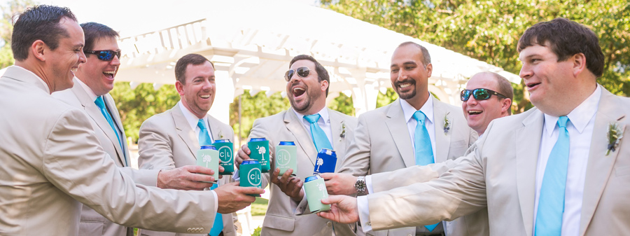 Groom and his buddies have a toast before croquet on the lawn at the Daniel Island Club. © Carolina Photosmith