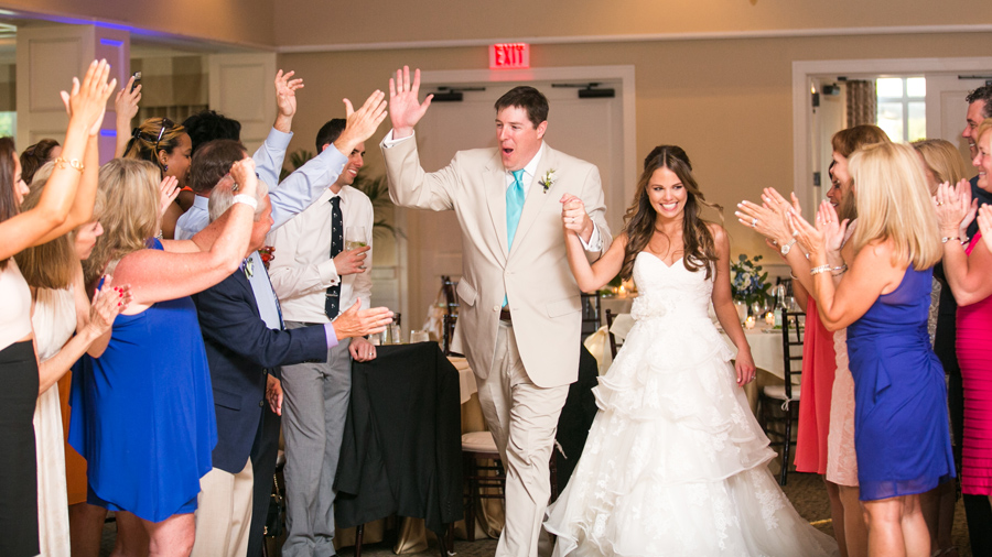 Newlyweds are jubilantly received in the Daniel Island Club. © Carolina Photosmith