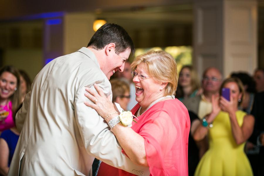 Groom shares a laugh with Mom on the dance floor of his Daniel Island Club wedding reception. © Carolina Photosmith