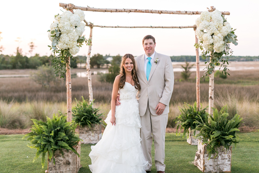 Gorgeous wedding arbor by Out of Hand in Mt Pleasant, SC, at Daniel Island Club ceremony. © Carolina Photosmith