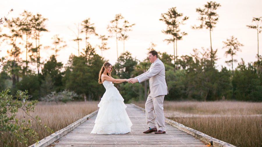 A song and a twirl for his girl on the boardwalk of the Daniel Island Club. © Carolina Photosmith