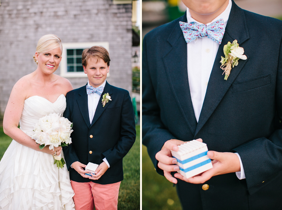 Maine bride in striped gown with ring bearer in lobster tie with Lego ring box © Carolina Photosmith