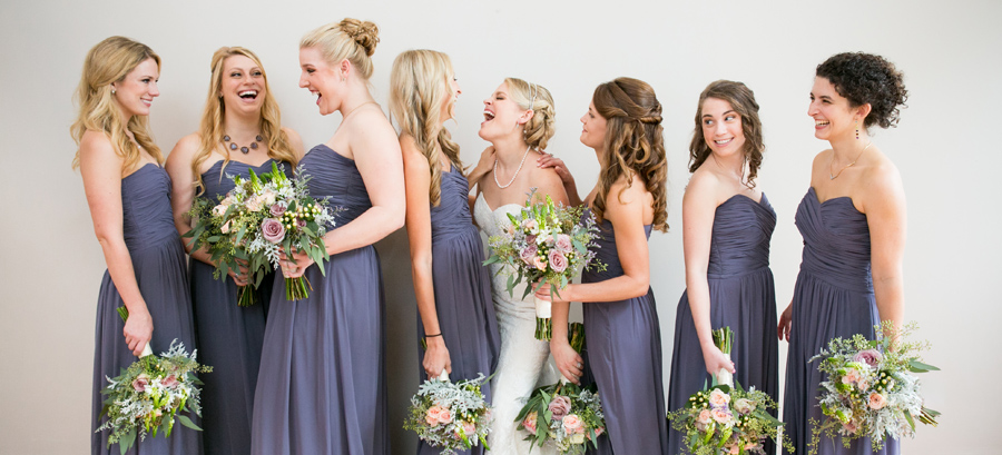 Beautiful florals by Pretty Petals in Summerville, SC, for this jubilant at-home Charleston wedding. © Carolina Photosmith