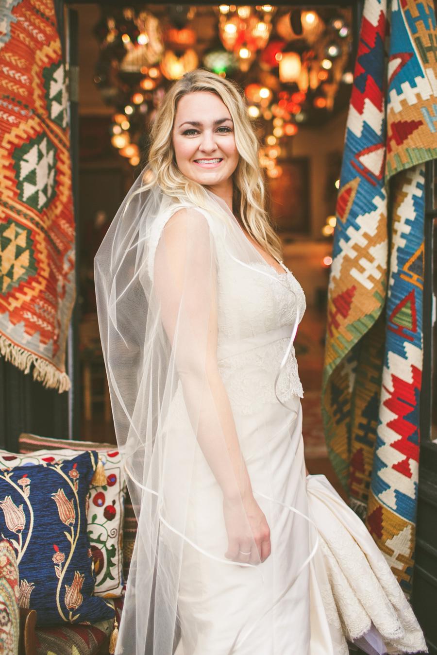 Colorful Charleston bride in a King Street storefront © Carolina Photosmith