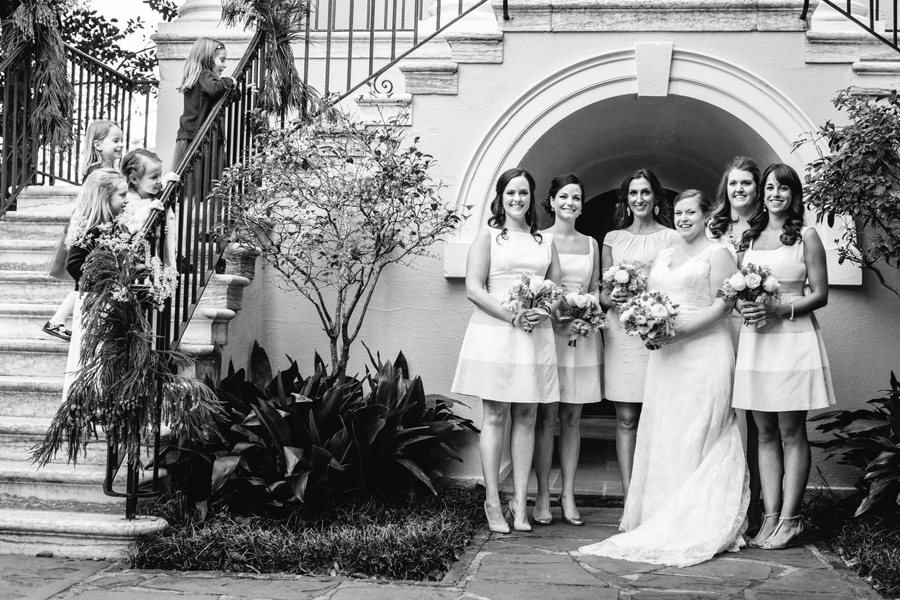 Little ones look on at the bride and her bridesmaids before a winter wedding at Circular Congregational Church in Charleston. ©Carolina Photosmith
