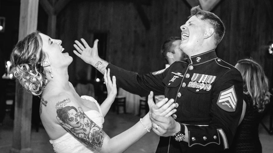 Newlyweds croon at Boone Hall Cotton Dock. Charleston-wedding-photography-highlights-by-Carolina-Photosmith-