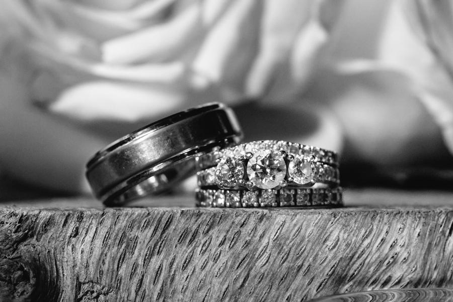 Wedding rings with roses and tree slab. Favorite-Charleston-wedding-photography-highlights-by-Carolina-Photosmith-