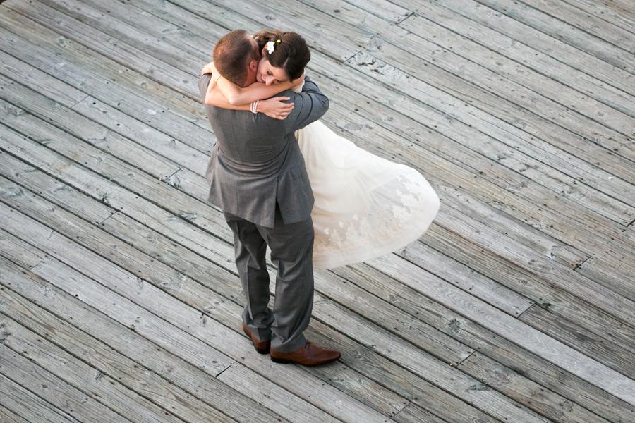 Twirling his girl on the dock. Favorite-Charleston-wedding-photography-highlights-by-Carolina-Photosmith-