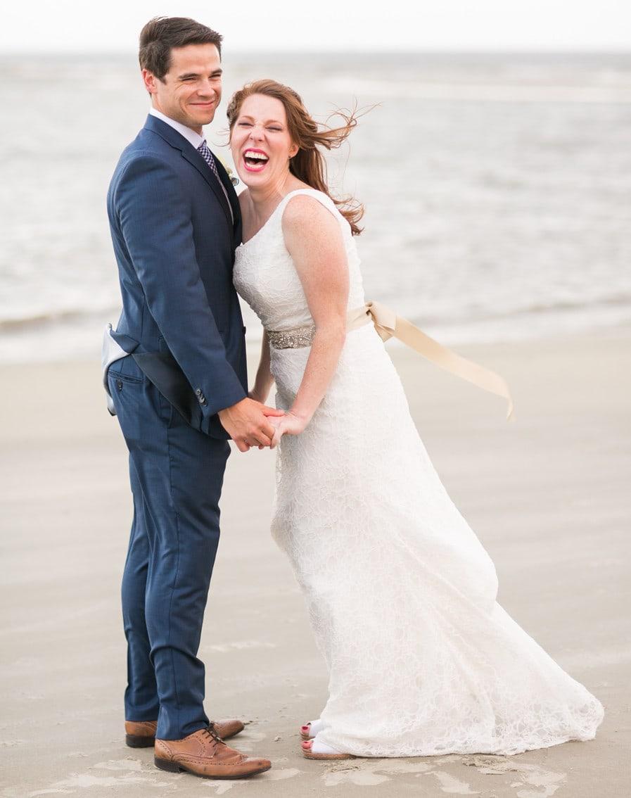 Newlyweds beach bliss after King & Prince wedding on St. Simons Island. © Carolina Photosmith