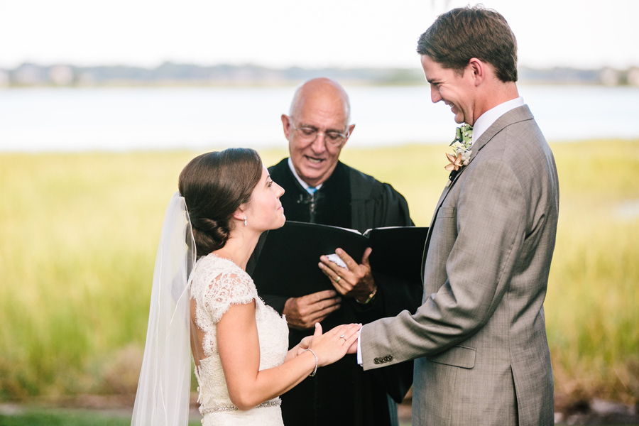 Jill and Kyle exchange vows at River House in Charleston. ©Carolina Photosmith