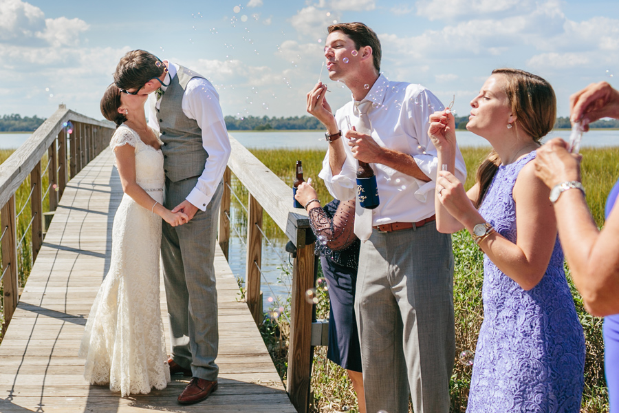 A bubbly departure for the Charleston newlyweds at Lowndes Grove. © Carolina Photosmith