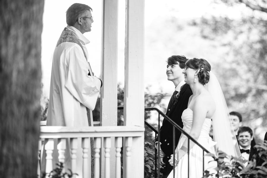 Exchanging vows in the gazebo of the Marietta Garden Center. ©Carolina Photosmith