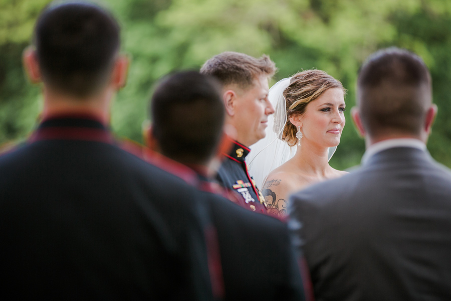 Moment at the outdoor altar exchanging vows at Boone Hall Plantation. ©Carolina Photosmith
