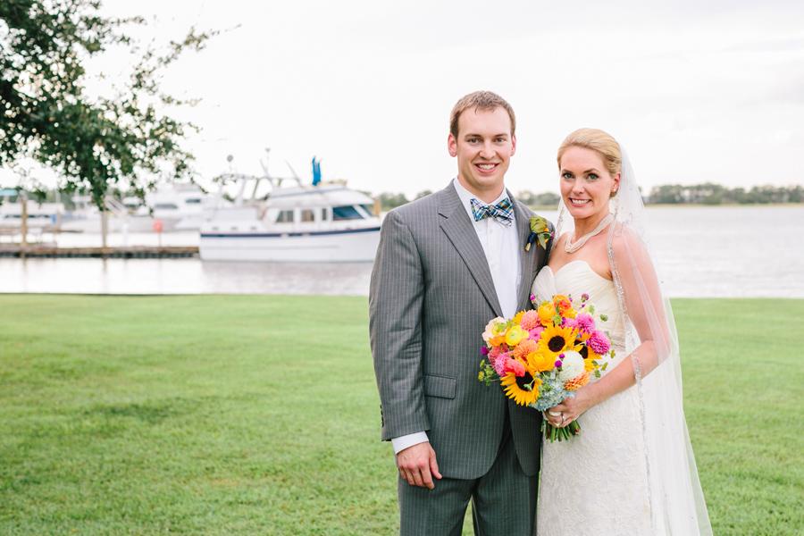 Island House newlyweds at this colorful summer wedding by the Stono River. ©Carolina Photosmith
