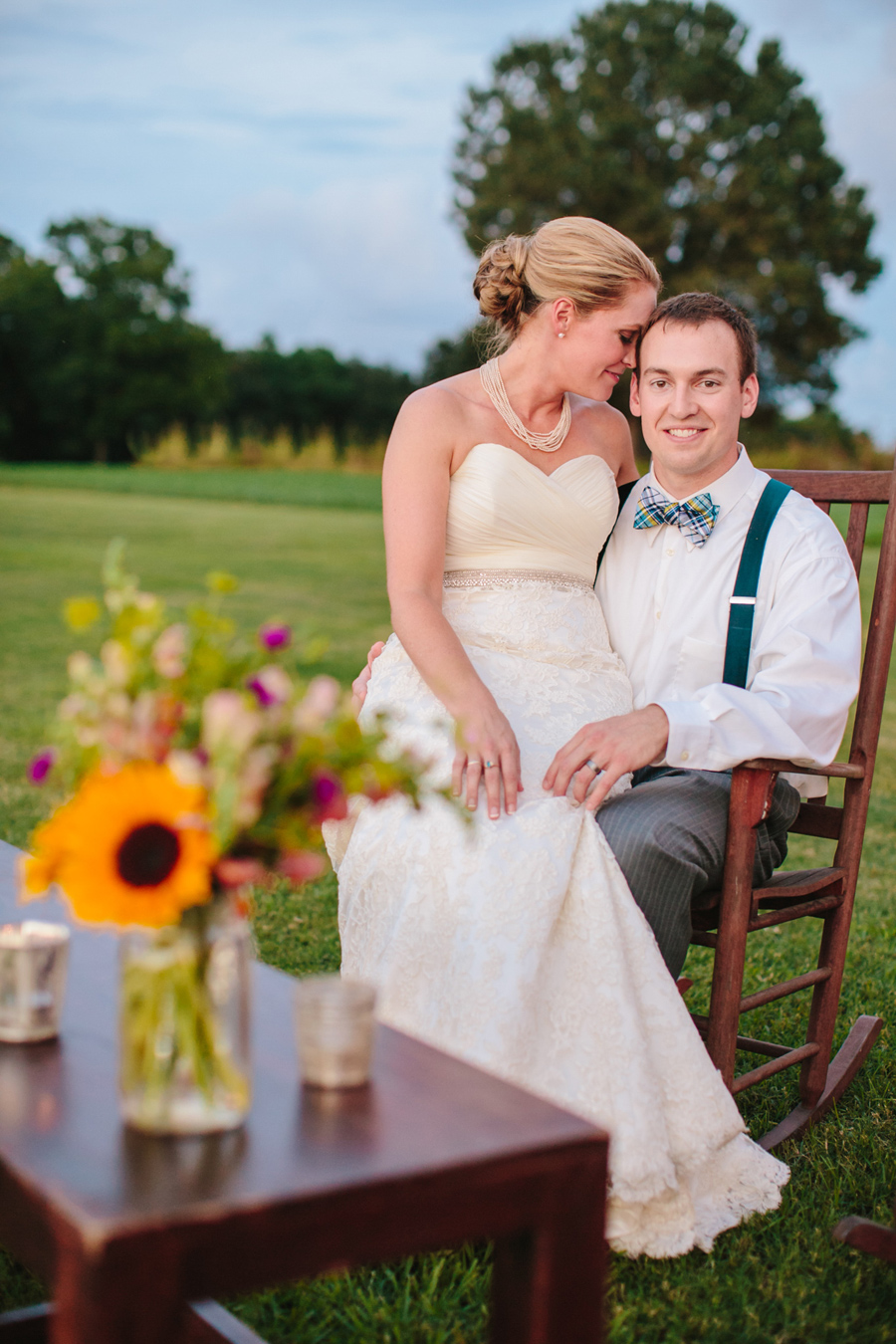Quintessential Charleston wedding bliss with colorful flowers and a rocking chair by the river at this Island House wedding. © Carolina Photosmith