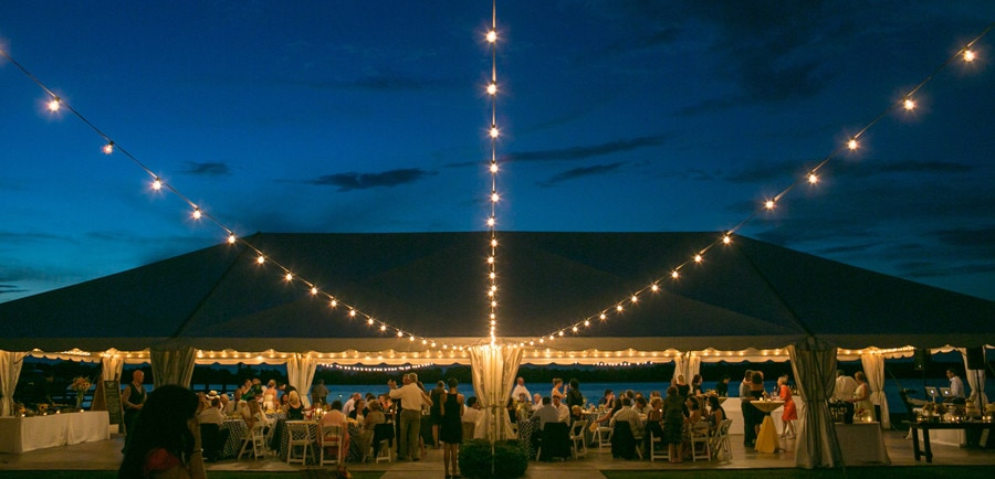 Twinkly lights surround the tent at this Island House wedding. © Carolina Photosmith