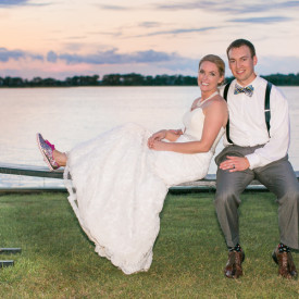 Newlyweds soak up sunset on a Charleston joggling board at this colorful Island House wedding. © Carolina Photosmith