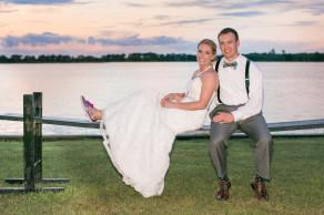 Newlyweds soak up sunset on a Charleston joggling board at this colorful Island House wedding. © Carolina Photosmith