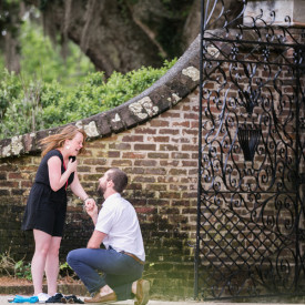 She said yes after a family outing turned into a surprise proposal at Boone Hall Plantation. © Carolina Photosmith