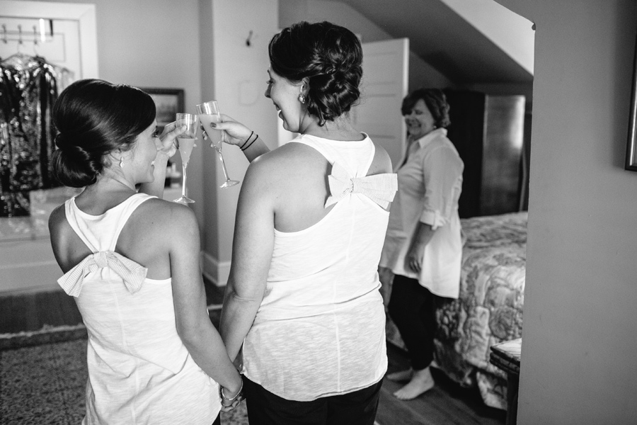 Bride toasts her sister mom looks on River house Charleston