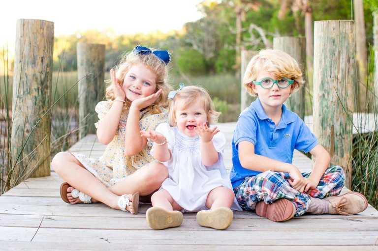 Charleston family photography. Colorful kids in county park. © Carolina Photosmith.